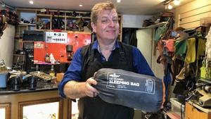 Jim Brennan repairs sleeping bags for homeless people
