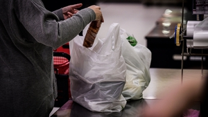 Supermarkets will be barred from offering lightweight plastic carrier bags at their checkouts
