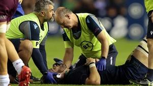 Ben Toolis lies injured on the Murrayfield pitch