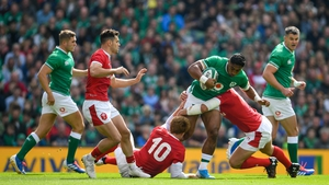 Ross Moriarty of Wales is tackled by Jean Kleyn, left, and Robbie Henshaw