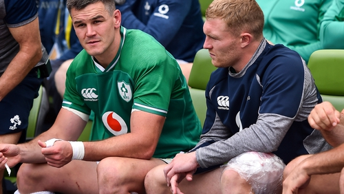 Keith Earls (r) with ice on his left leg