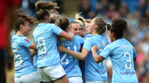 Manchester City players mob Caroline Weir after her spectacular goal at the Etihad
