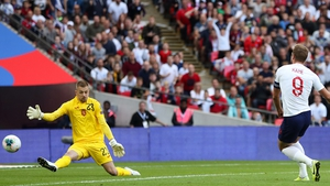 Harry Kane slots home his first goal against Bulgaria