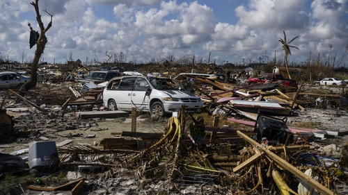 A vehicle sits amid the mud and destruction left by Hurricane Dorian in Marsh Harbour, Bahamas