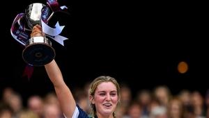 Mairead McCormack raises the trophy
