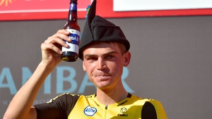 Team Jumbo rider US Sepp Kuss sinks a beer to celebrate his stage win