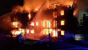 The fire destroyed the four-storey building in southwest London