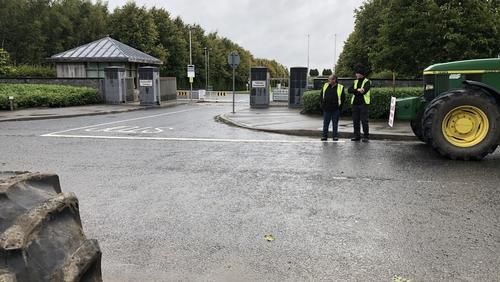 Some farmers are protesting outside the venue for the talks in Kildare