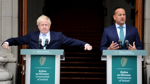 Boris Johnson attempts to conduct the media orchestra at yesterday's meeting with Taoiseach Leo Varadkar in Dublin