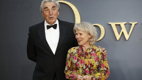 Jim Carter and Imelda Staunton pose on the red carpet upon arrival for the world premiere of the film Downton Abbey