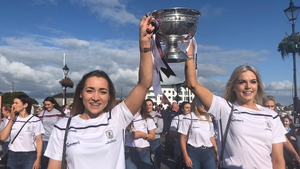 The victorious Galway camogie team carry the O'Duffy Cup across the Shannon into Connacht