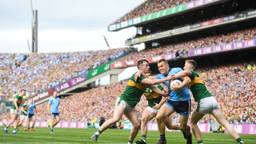 Con O'Callaghan of Dublin in action against Jason Foley of Kerry, right and Tom O'Sullivan of Kerry during the drawn game