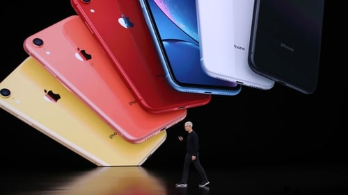 Apple CEO Tim Cook on stage unveiling the new iPhone 11