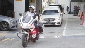 A hearse transporting Mugabe's body left a Singapore funeral home accompanied by a police escort