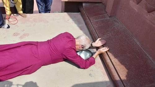 Archbishop of Canterbury Justin Welby prostrates himself at the site in northern India