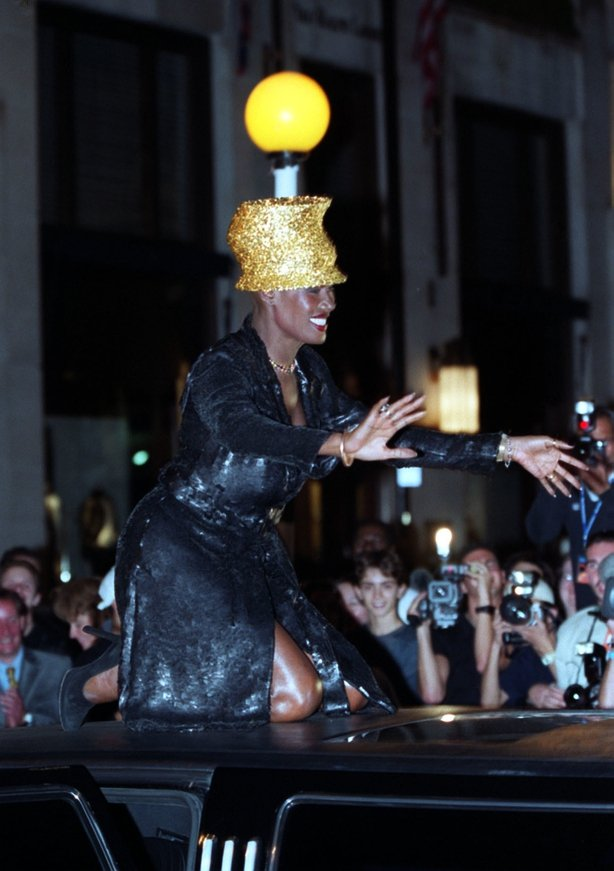 Grace Jones wears a hat creation by Philip Treacy whilst on the roof of a stretch Limousine (William Conran/PA)