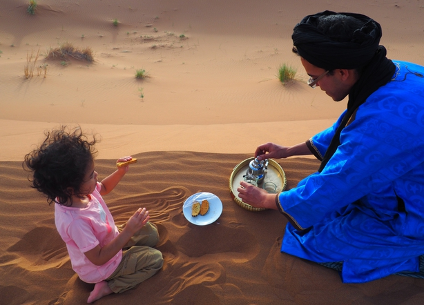 Nellie Huang and her family in the Sahara Desert (Nellie Huang/PA)