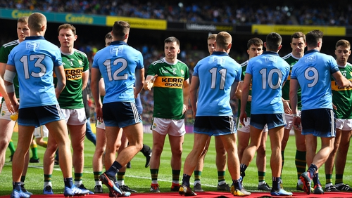 Kerry and Dublin players shake hands prior to the drawn game