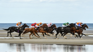 Jockeys urge their mounts along in the opener at Laytown, won by Plough Bay - swimming pre-race clearly works