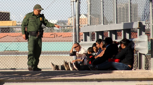 US authorities arrest migrants after crossing the Bravo river in Ciudad Juarez at the border between Mexico and USA