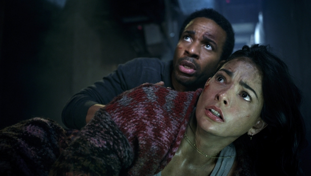 Andre Holland and Natalie Martinez in Battle at Big Rock via Universal
