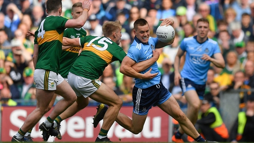 Con O'Callaghan of Dublin is tackled by Killian Spillane