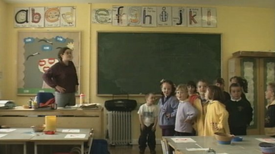 Gaelscoil Chnoc na Ré Principal Gina Nío Lionsigh in classroom with children (1999)