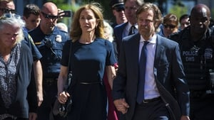 Felicity Huffman with husband William H Macy pictured at the courthouse before sentencing