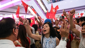 Pro-China supporters waving Chinese flags shout slogans against anti-government protesters
