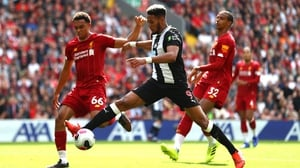 Joelinton is closed down by Trent Alexander-Arnold