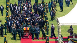 Officials accompany Robert Mugabe's coffin in Harare