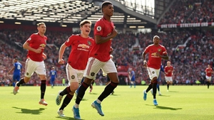 Marcus Rashford celebrates the only goal of the game