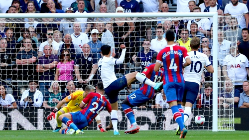 Son Heung-min (centre) scores the first goal of the game