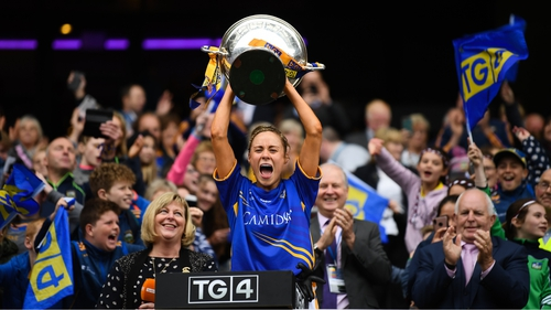 Samantha Lambert hoists the cup at Croke Park