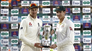 Captains Joe Root and Tim Paine pose with the series trophy at the end of the fifth test