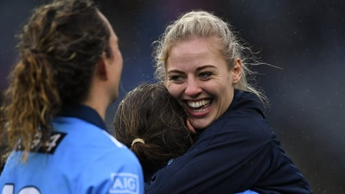 Nicole Owens embraces her team-mates after Dublin's All-Ireland victory