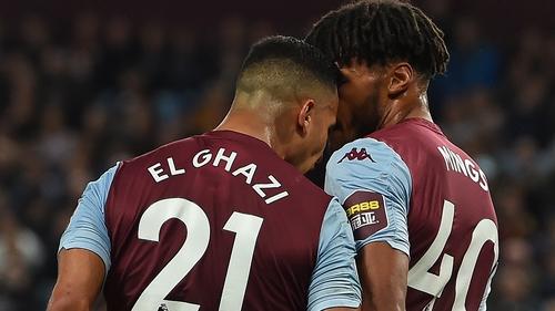 Aston Villa's Dutch striker Anwar El Ghazi (L) goes head to head with Tyrone Mings