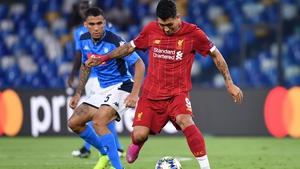 Roberto Firmino (R) holds off Napoli's Brazilian defender Allan