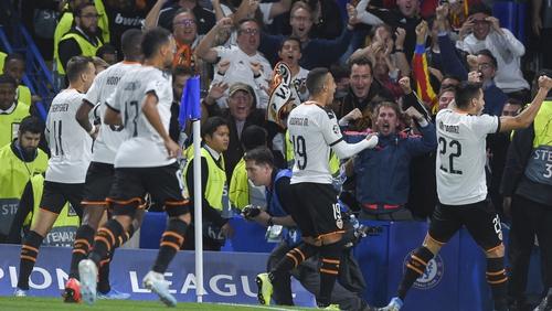 Rodrigo Moreno celebrates with the travelling fans