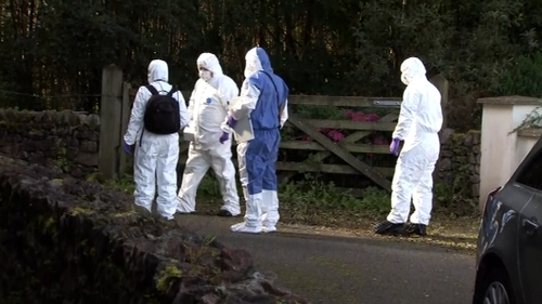 Forensic investigators examine the scene where Kevin Lunney was abducted