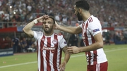 Mathieu Valbuena salutes the crowd after equalising from the spot in Piraeus