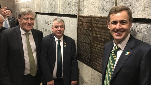 Irish Ambassador to the US Daniel Mulhall, Minister of State Kevin 'Boxer' Moran and Senator Mark Daly alongside the plaque at the Washington Monument