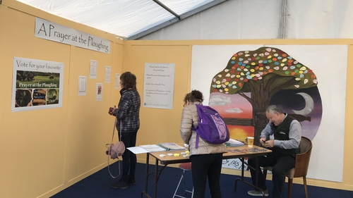 Visitors at the National Ploughing Championships voting for their favourite prayer