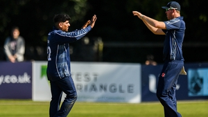 Hamza Tahir (left) had a great day for the Scots at Malahide Cricket Club