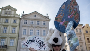 A woman wearing a polar bear costume attends a protest against climate change at the Old Town Square in Prague, Czech Republic