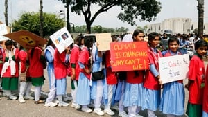 Bangladeshi school and college students hold placards during the global climate change strike in Dhaka