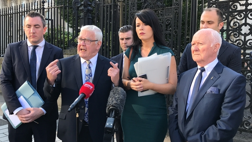 Francis McGuigan (2nd L) and Liam Shannon (R) expect the PSNI to appeal the decision to the Supreme Court in London