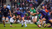 Jacob Stockdale on his way to scoring a try in this year's Six Nations clash