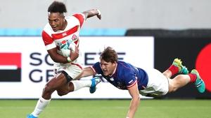 Kotaro Matsushima (L) breaks away to score Japan's fourth try