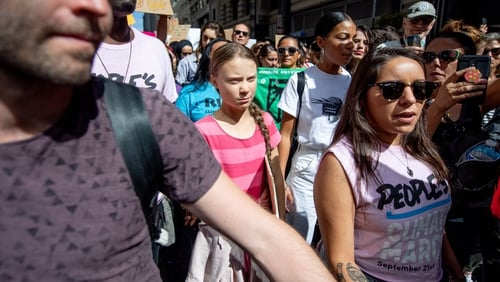 Greta Thunberg (pink top) joined young activists demonstrating in New York